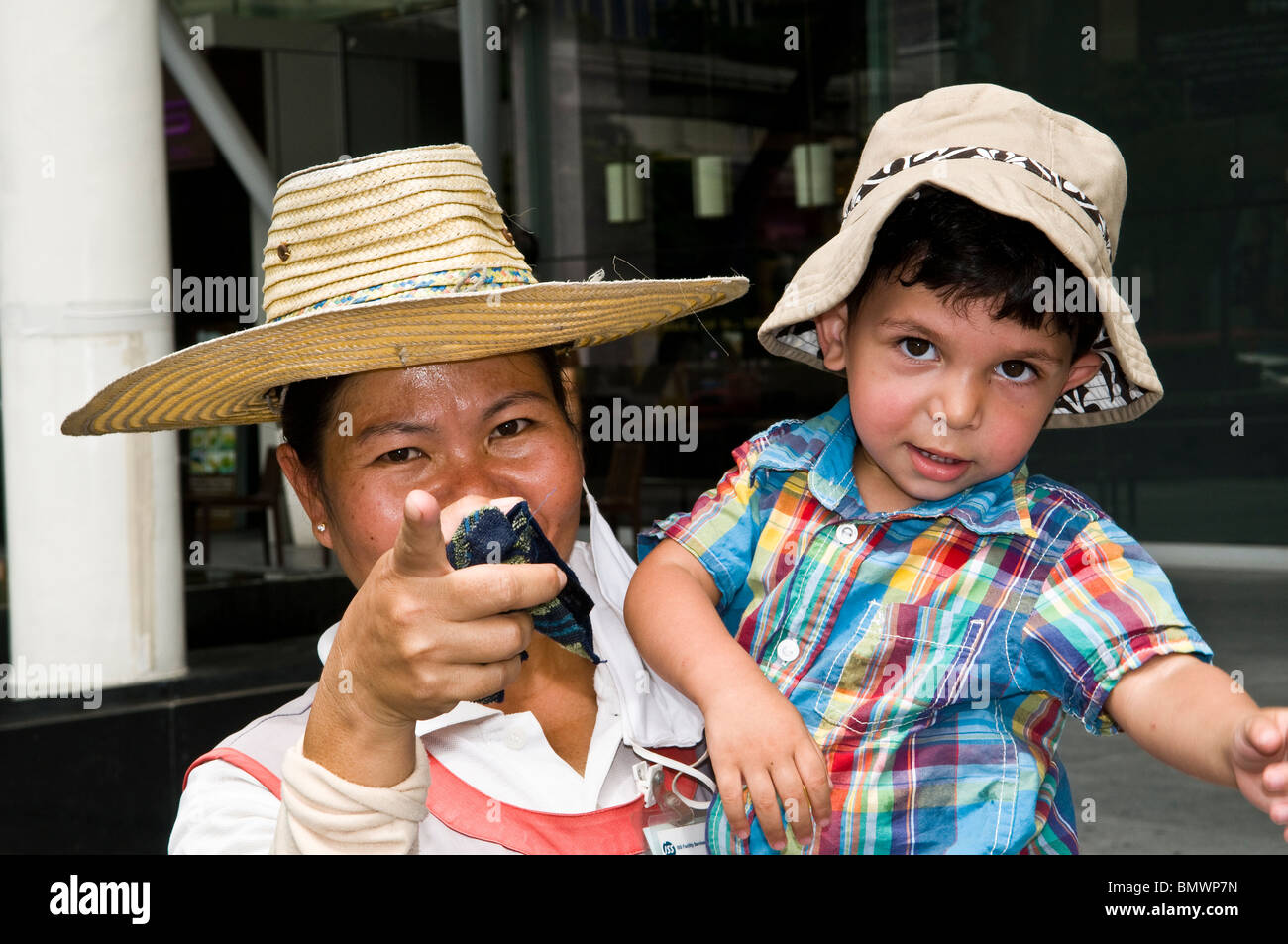 A cute boy in the hands of his nanny. - Stock Image