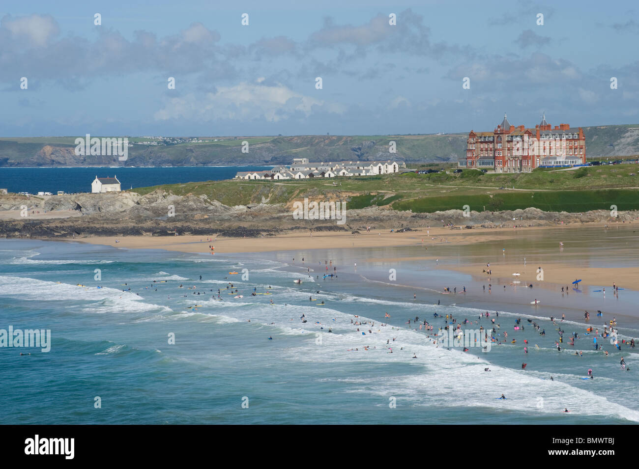 People swimming and body boarding at a beach near Newquay in Cornwall, England - Stock Image