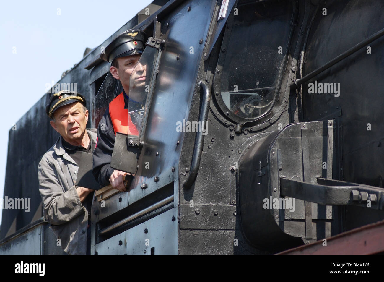 Locomotive Engineer and Fireman looking out of a 01 German Steam Locomotive - Stock Image