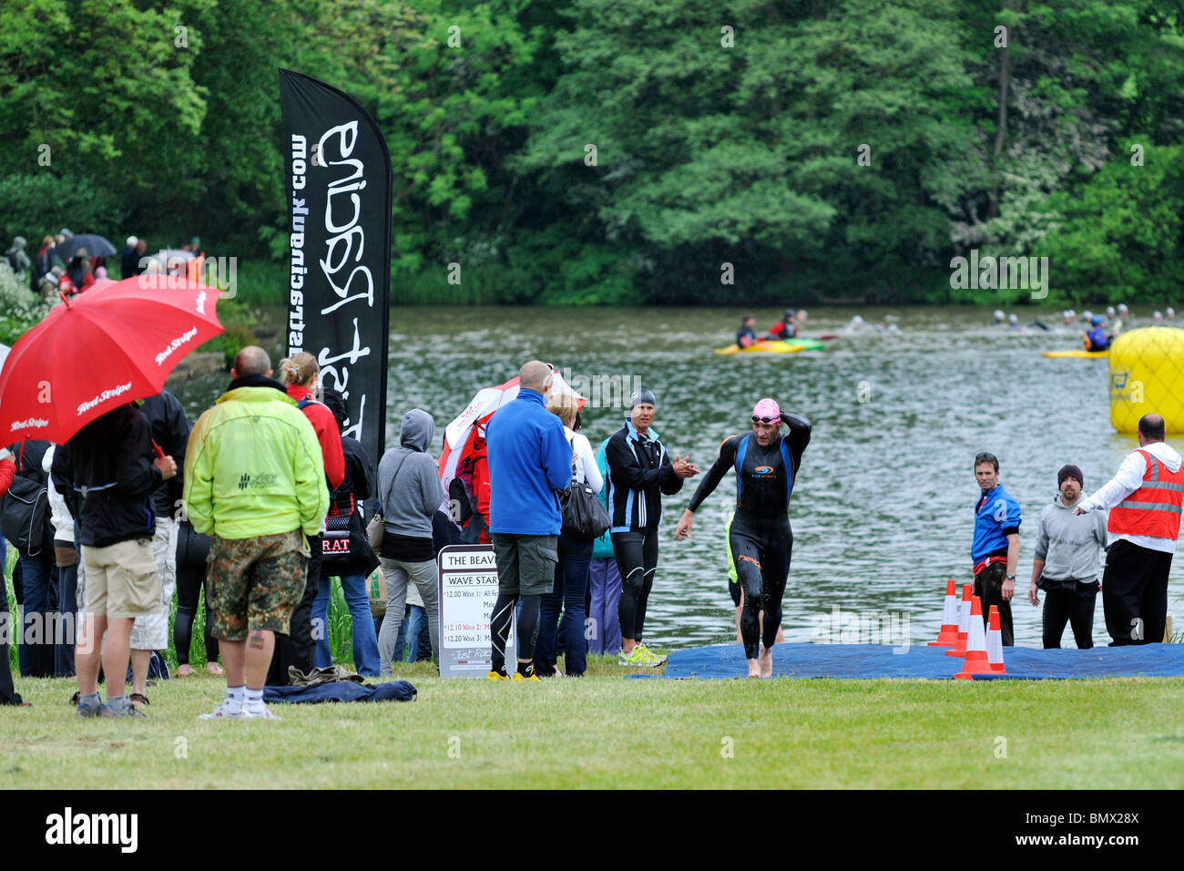 A swimmer 'in transition' between the swim and bike sections of the 2010 'Little Beaver' triathlon, - Stock Image