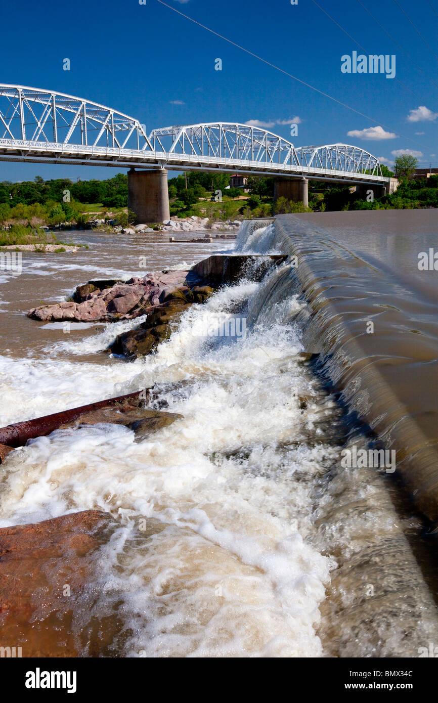 A bridge, dam and waterfall on the Llano river, Llano, Texas, USA. - Stock Image
