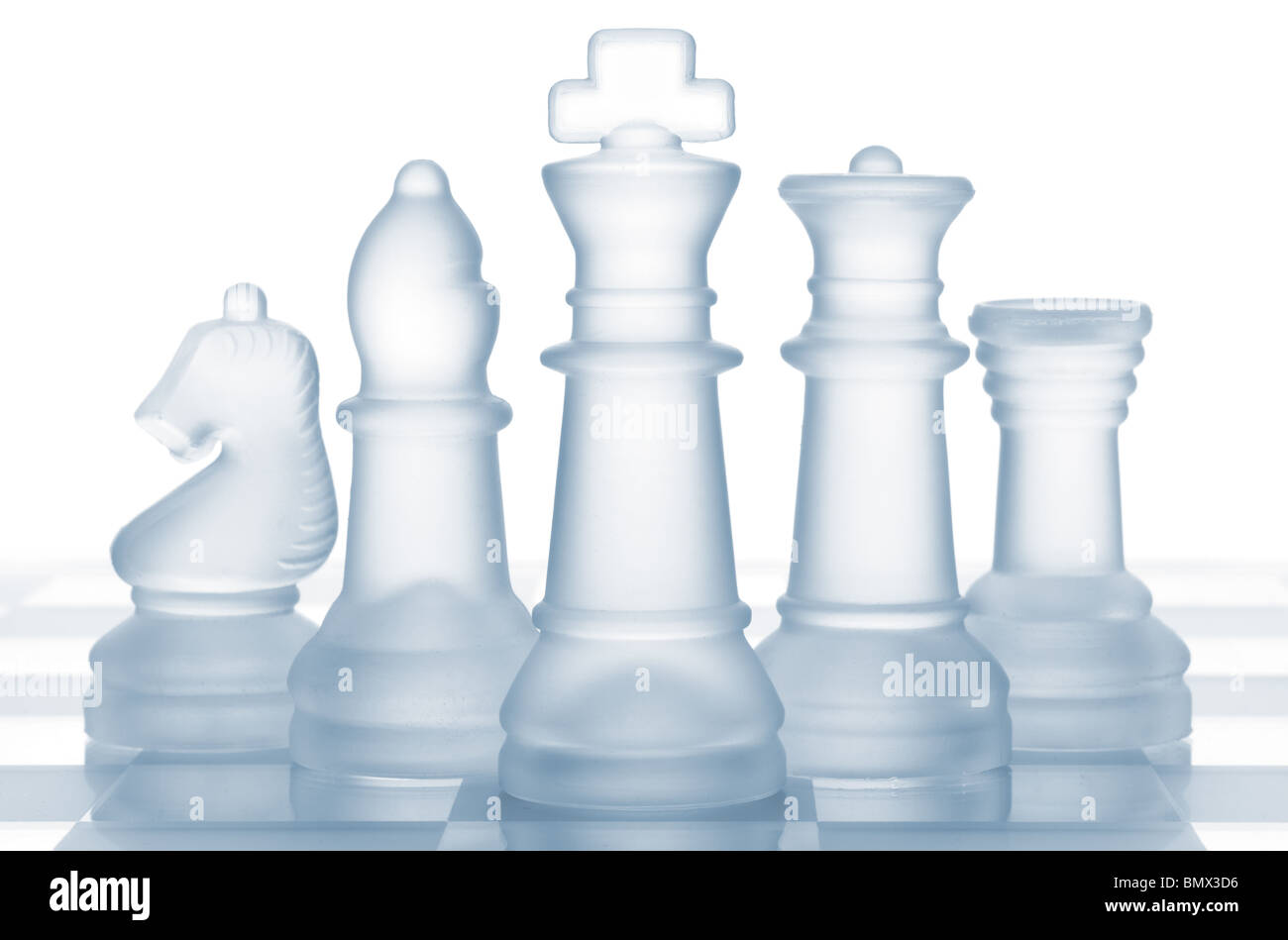 transparent glass chess isolated on white - Stock Image