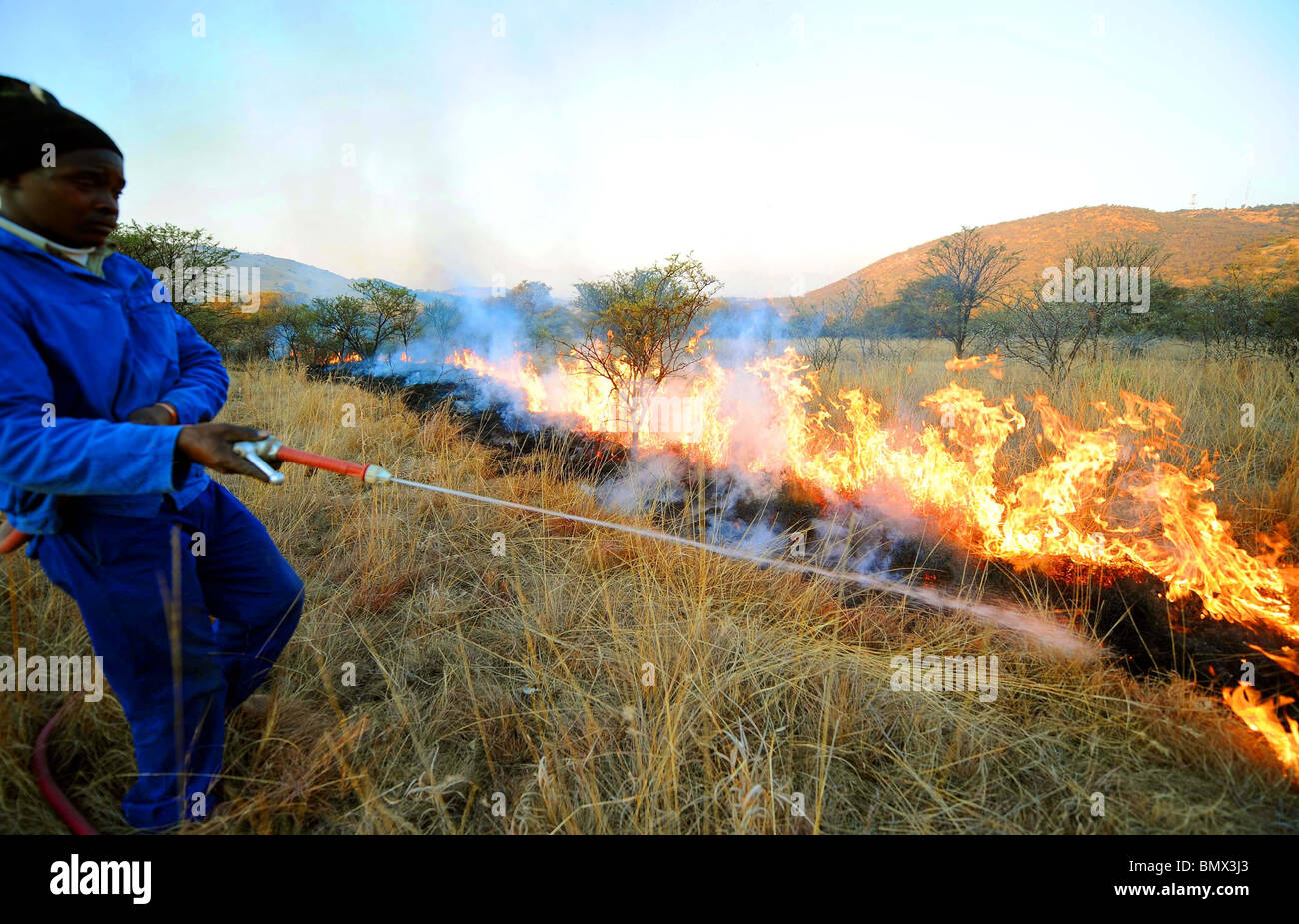 RANCH WORKERS CREAT FIREBREAKS 2010 FIFA WORLD CUP SOUTH AFRI KARMA RANCH  SOUTH AFRICA 21 June 2010 - Stock Image