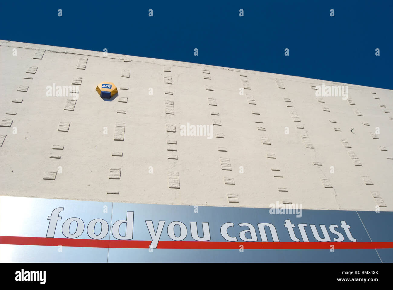 food you can trust, a slogan of the supermarket chain iceland on a branch of the store in whitton, middlesex, england - Stock Image