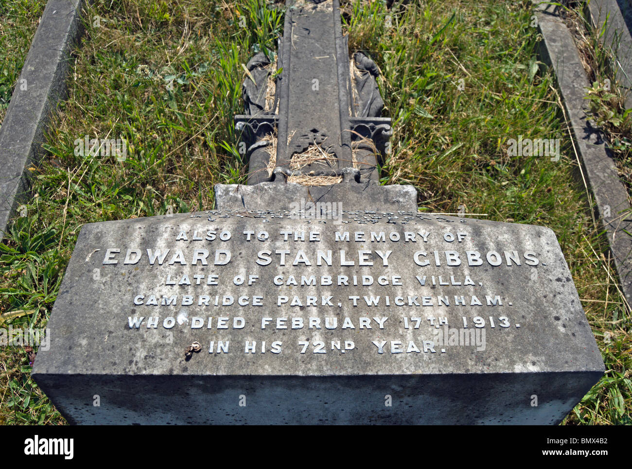 damaged tombstone of philatelist edward stanley gibbons, in twickenham cemetery, middlesex, england - Stock Image