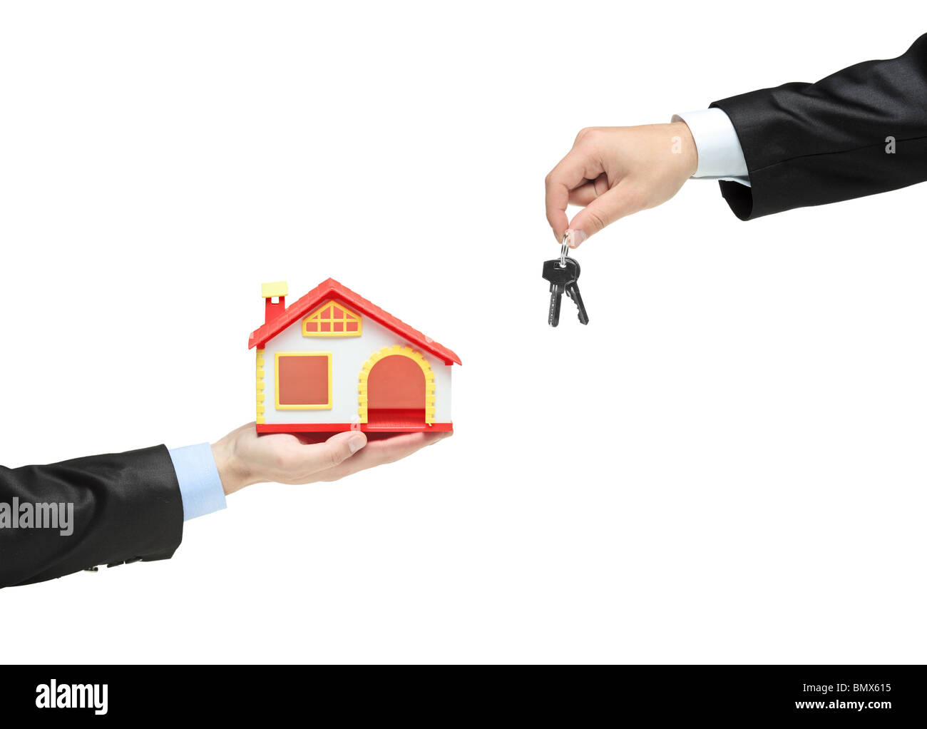 Real estate agent holding keys from your new house - Stock Image