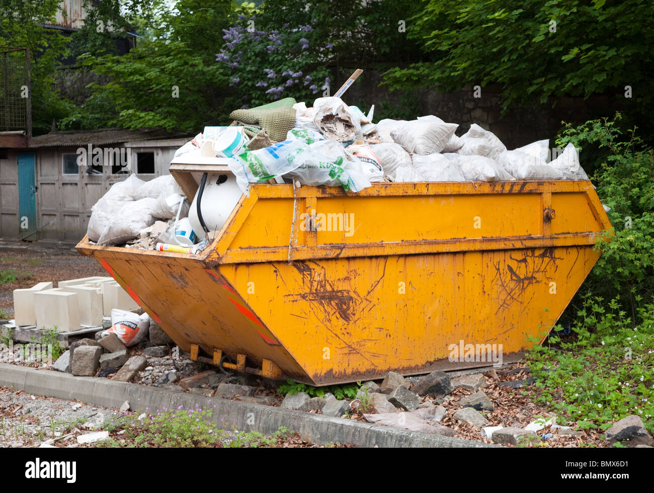 Skip filled with rubbish waiting for disposal England UK - Stock Image