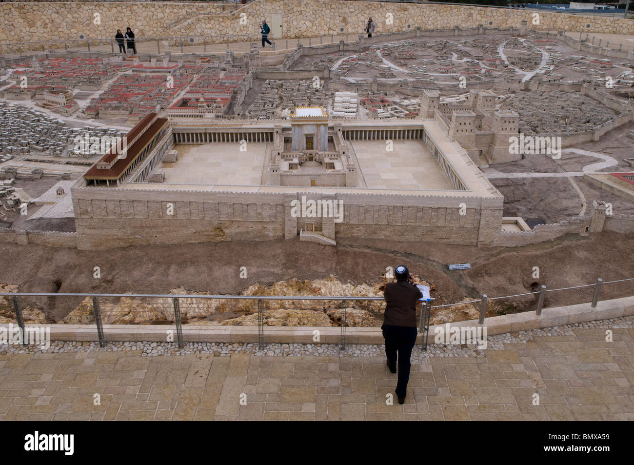 A religious Jew looking at a scale model of Jerusalem in the Second Temple Period placed at the campus of Israel Stock Photo