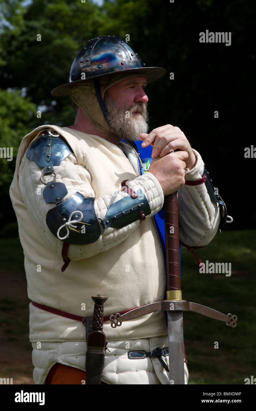 Armoured Common Scottish Foot Soldier large, double-handed sword_ A re-eanctor in the costume of the period & - Stock Image