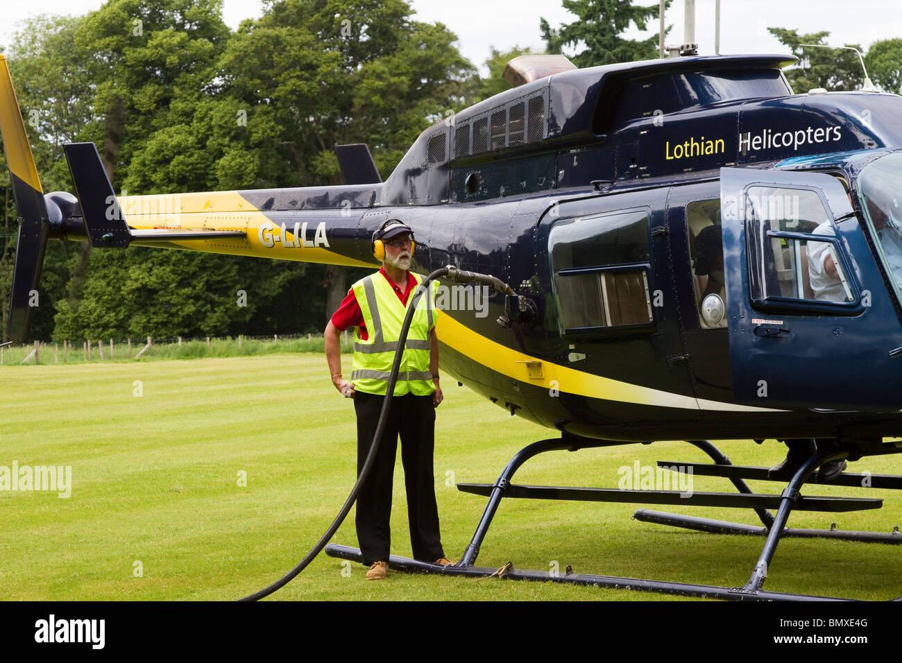Refuelling G-LILA_Bell 206L4 LongRanger IV - Stock Image