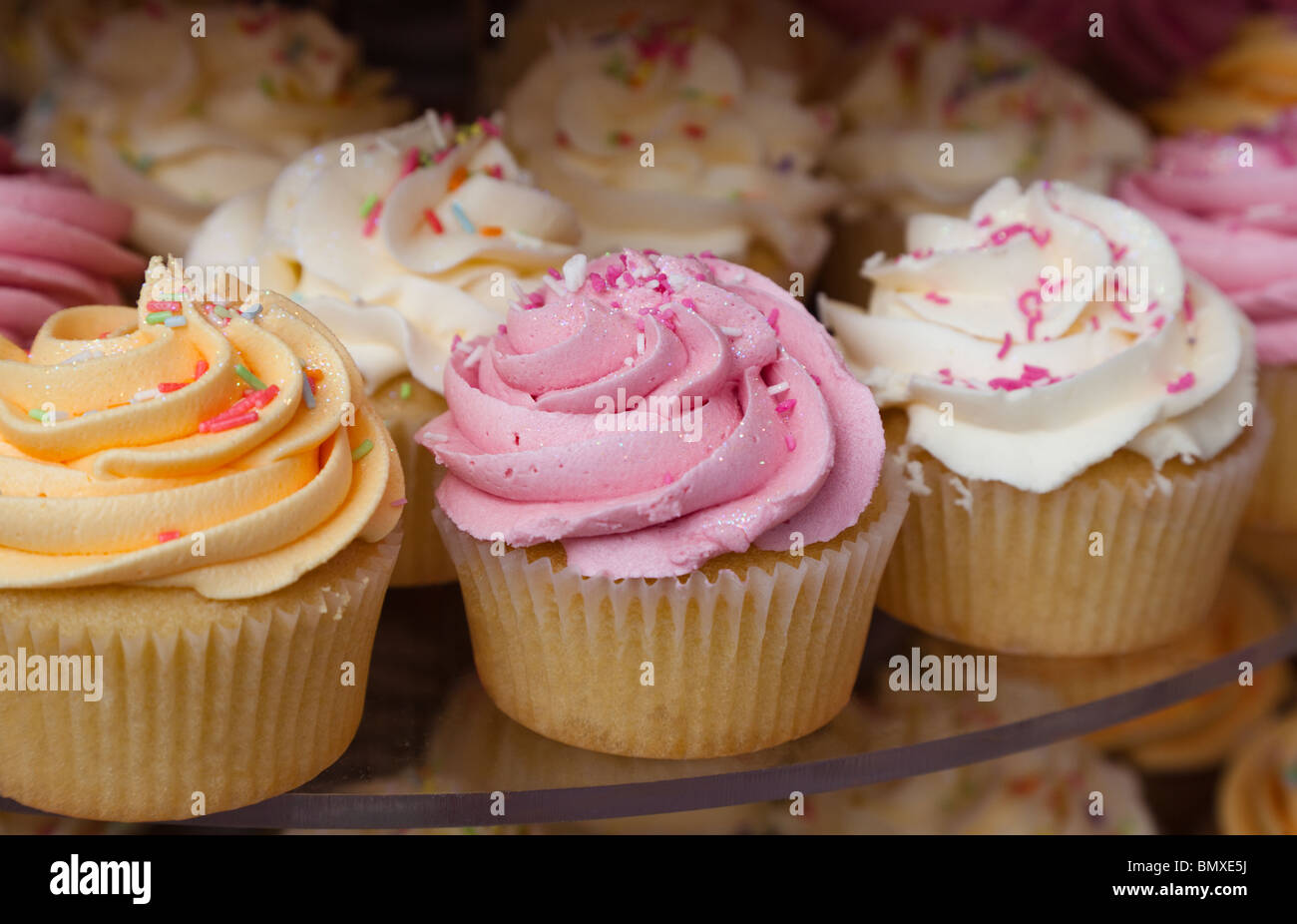 Stack of cup cakes with sugar icing on display, Glasgow, Scotland - Stock Image
