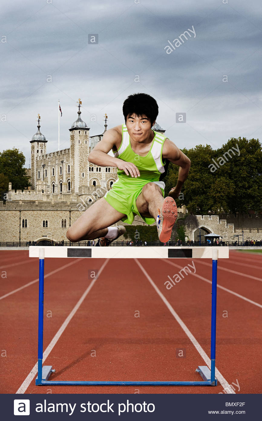 Hurdler and tower of london - Stock Image