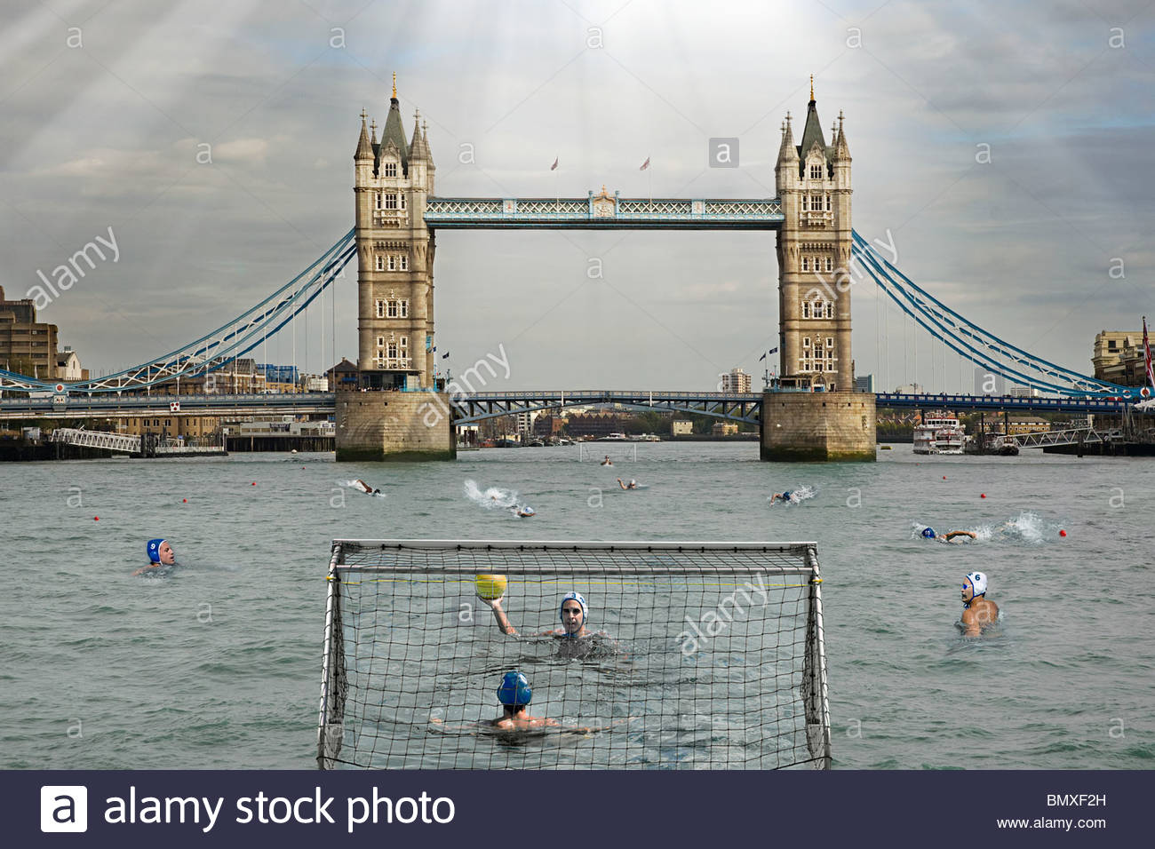 People playing water polo in river thames - Stock Image