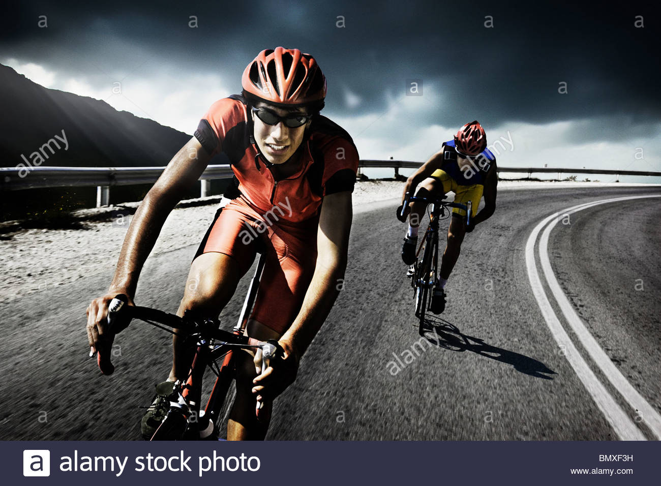 Racing cyclists on road - Stock Image