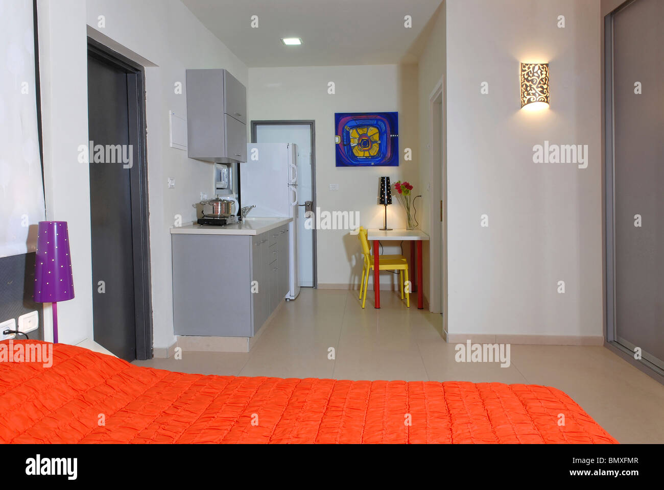 One Room studio apartment with bed and kitchenette in view ...