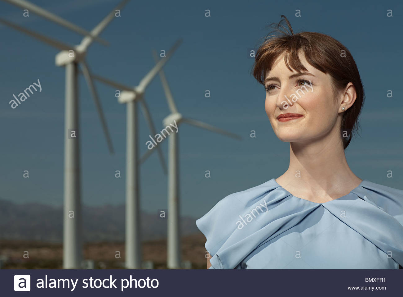 Woman and wind turbines - Stock Image