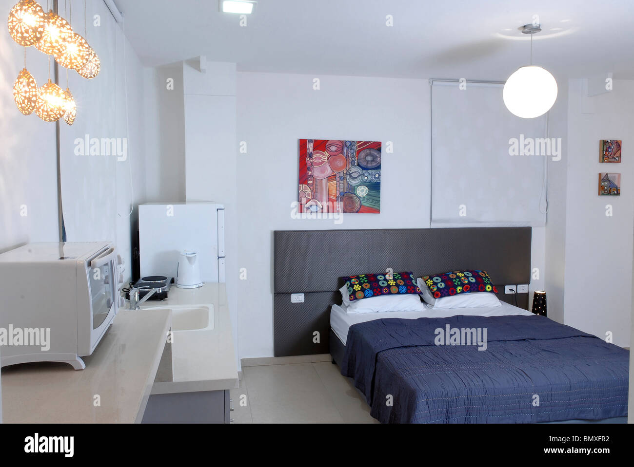 One Room Studio Apartment With Bed And Kitchenette In View Stock Photo Alamy