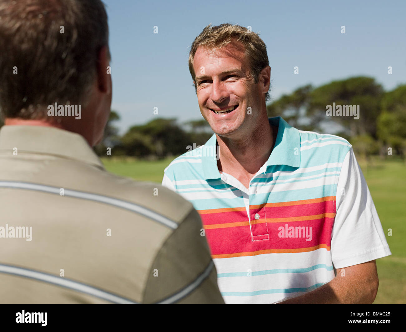 Two mature men playing golf together - Stock Image