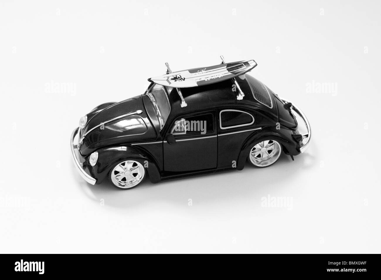 A Die Cast Model of a Child's Toy car On White Card - Stock Image