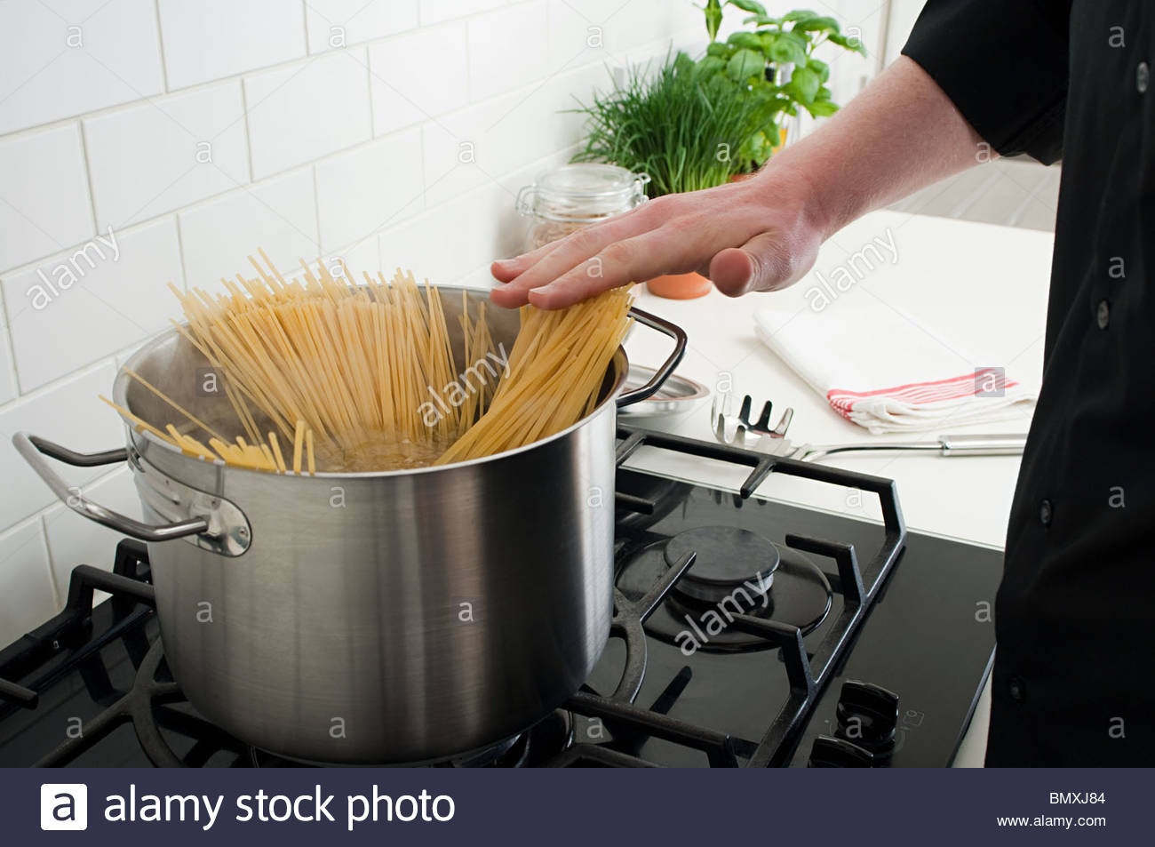 Cooking spaghetti - Stock Image
