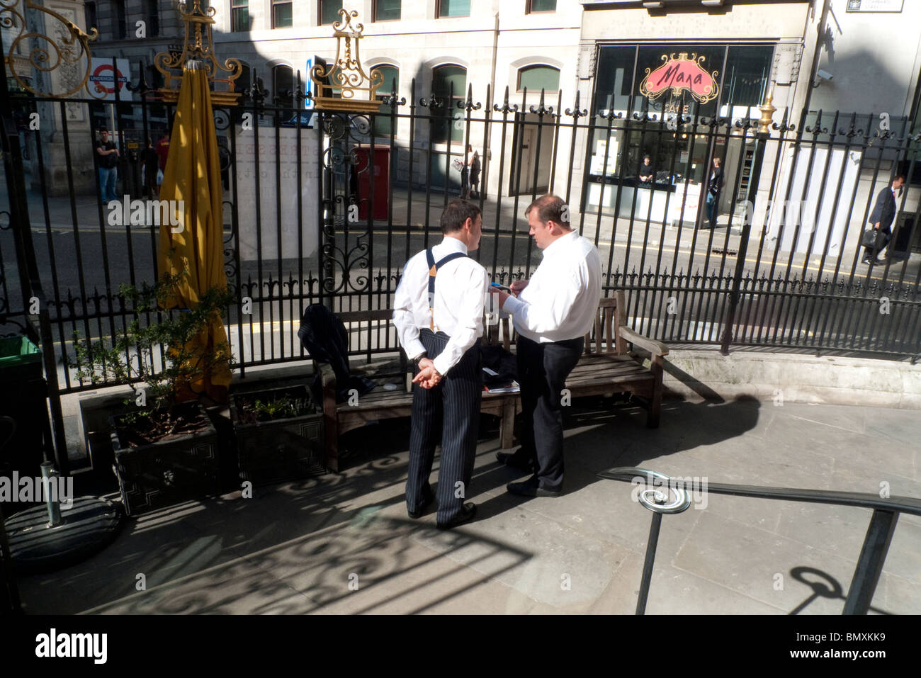 Businessmen talking outside St Mary Wolnoth church in Lombard Street City of London England UK  KATHY DEWITT - Stock Image