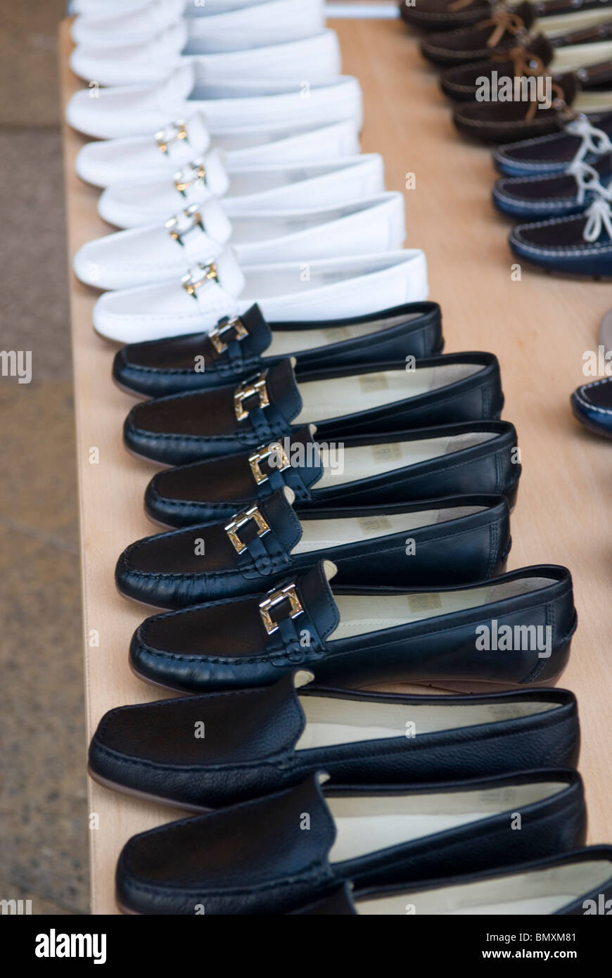 Shoes on sale at a stall Berlin Germany - Stock Image