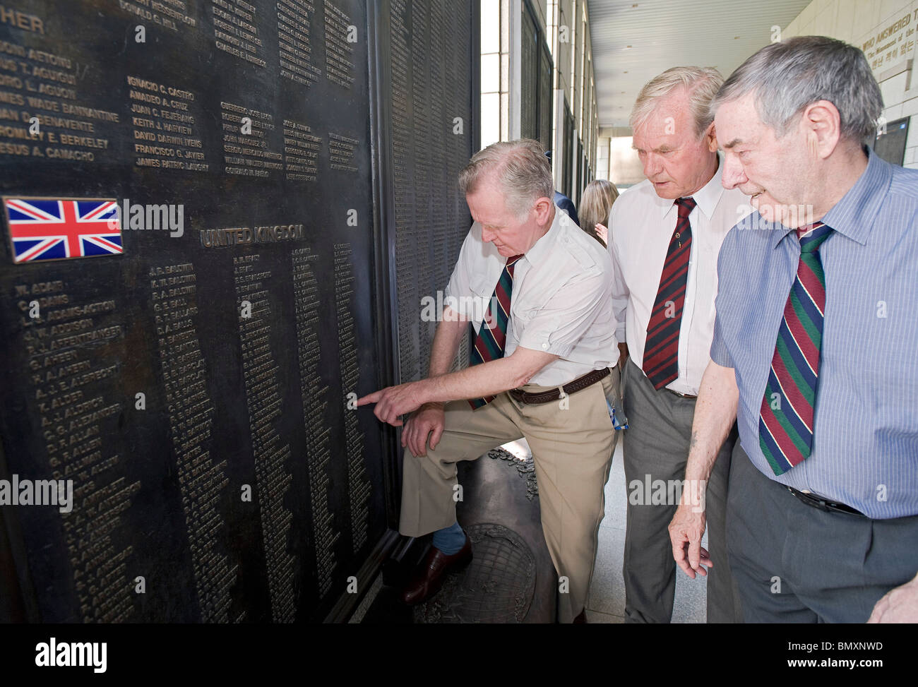 British Korean War veterans look at the names of fellow British