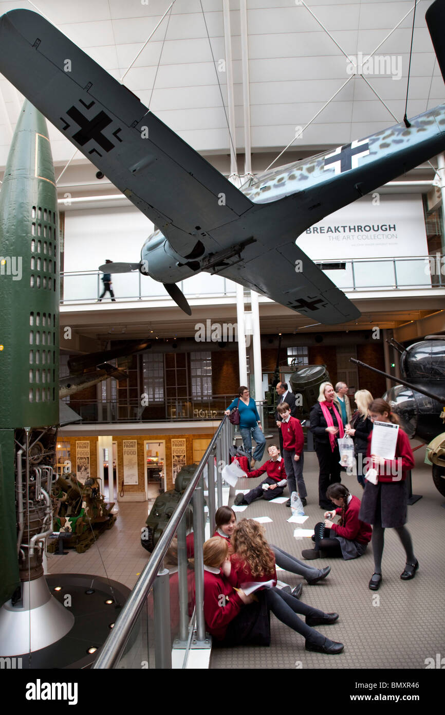 Interior main atrium at the Imperial War Museum, London. Aircraft from the First and second World Wars suspended. - Stock Image