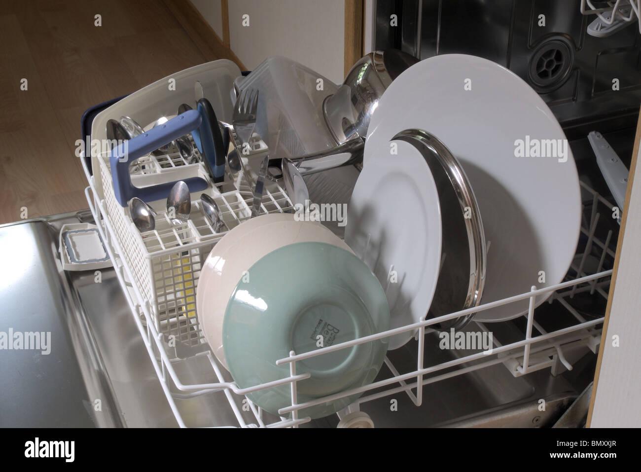 Open Domestic Dishwasher filled with Crockery, UK - Stock Image