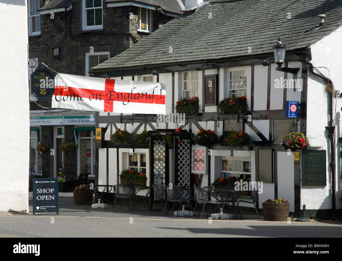 Queens Arms pub in the village of Hawkshead - with England World Cup banner - Cumbria, England UK - Stock Image