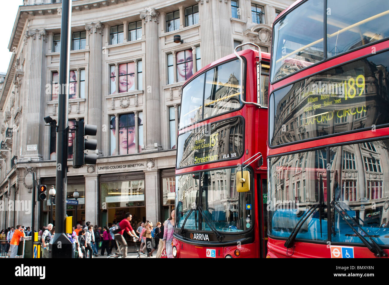 London buses and United Colors of Benetton shop on Oxford Circus, London, UK - Stock Image