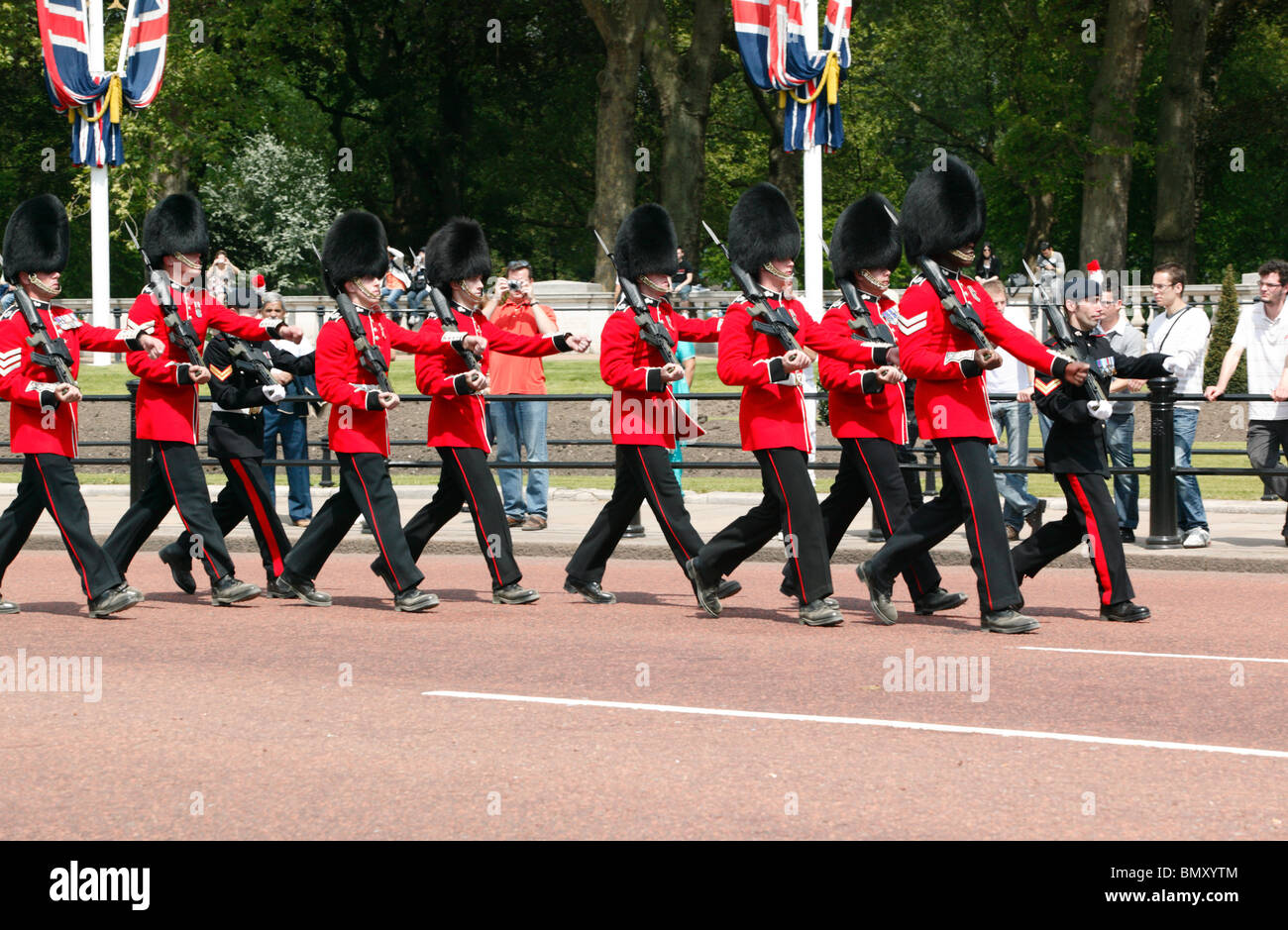 Guardsmen  participating in changing the guard, outside  Buckingham Palace, London - Stock Image