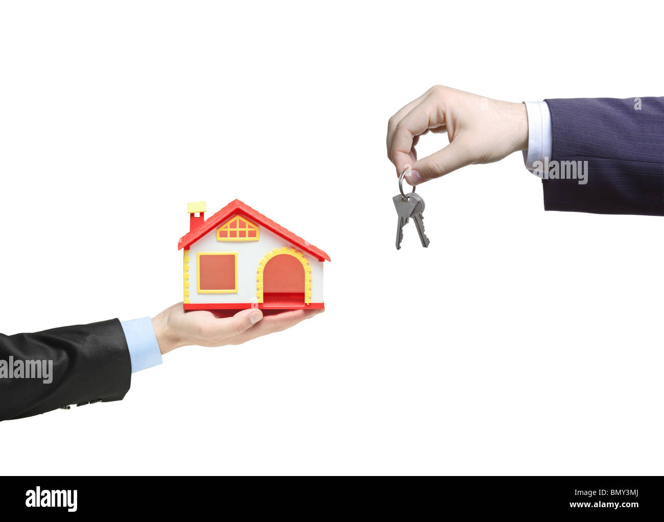 Real estate agent holding keys from your new home - Stock Image