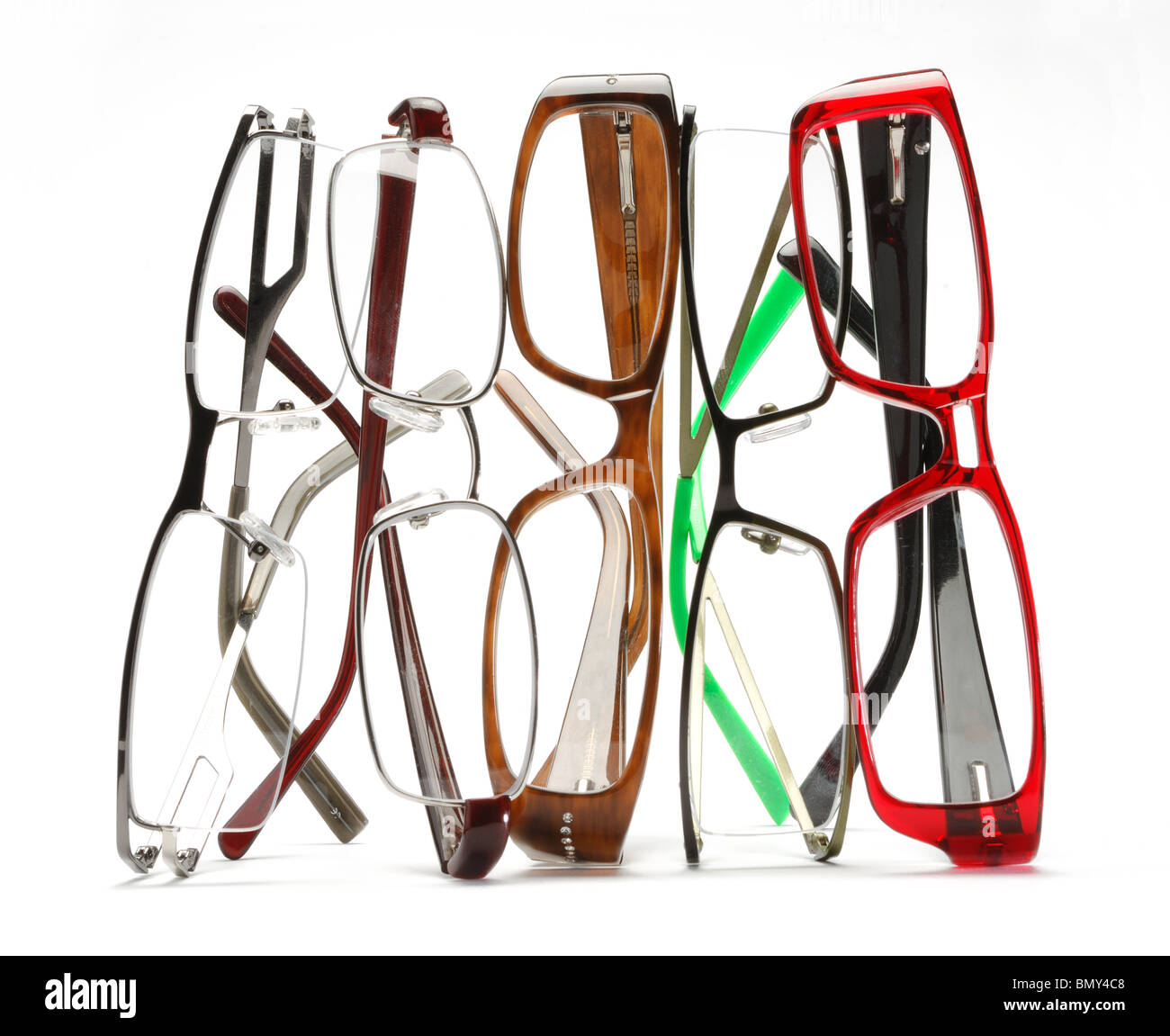A stack of colorful eye glasses on a white background - Stock Image