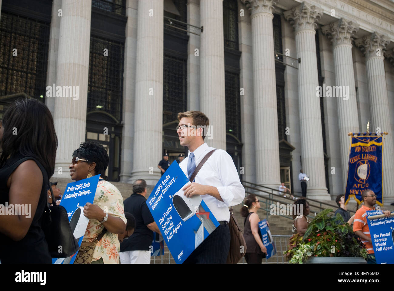 Postal workers rally in front of the James Farley Post Office in New York demanding continuation of Saturday delivery - Stock Image