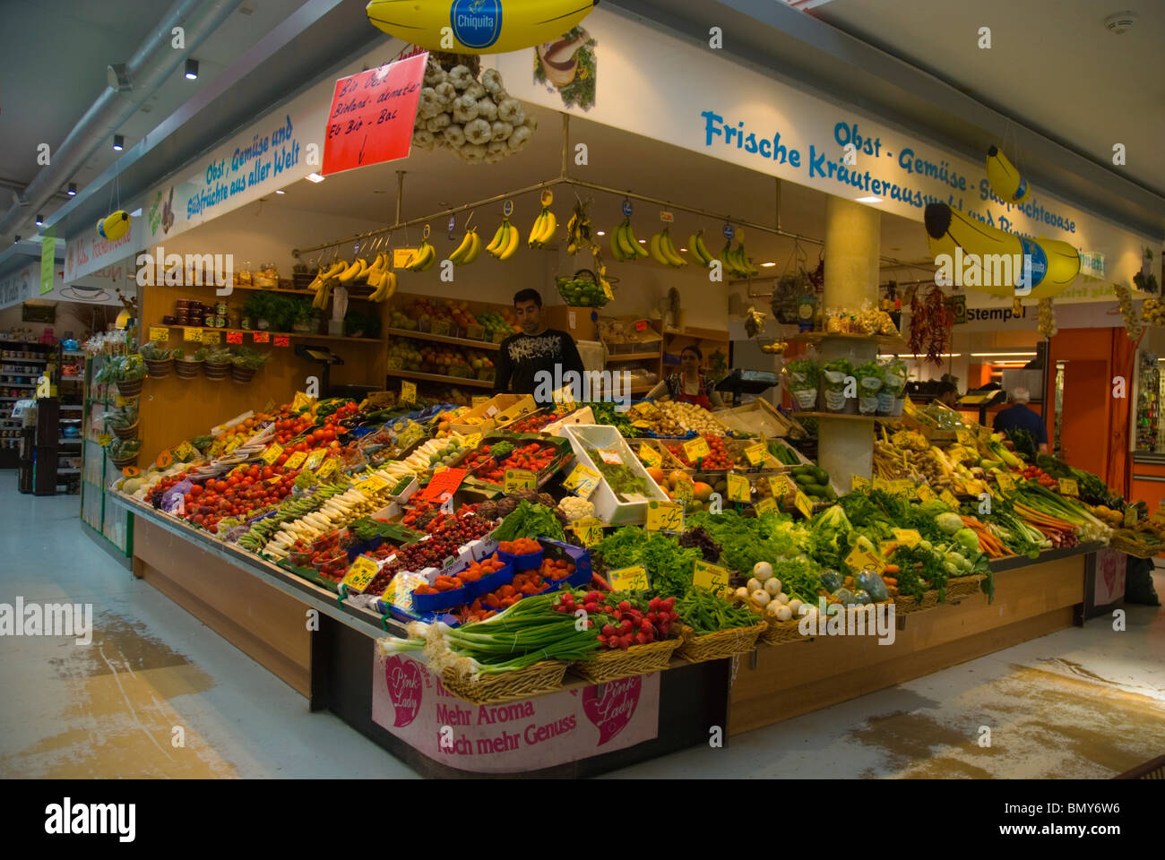 Greengrocer in Marheineke Markthalle market hall Kreuzberg west Berlin Germany Europe - Stock Image