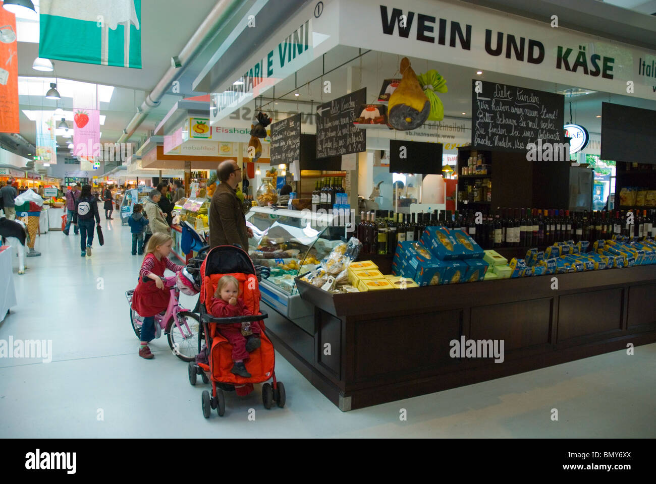 Wine and cheese stall Marheineke Markthalle market hall Kreuzberg west Berlin Germany Europe - Stock Image