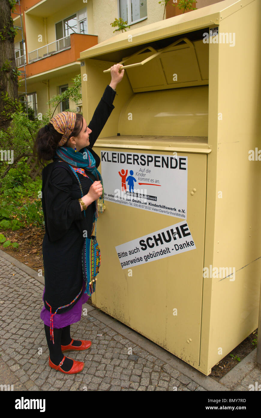 Woman in her late 20s donating clothes Berlin Germany Europe - Stock Image