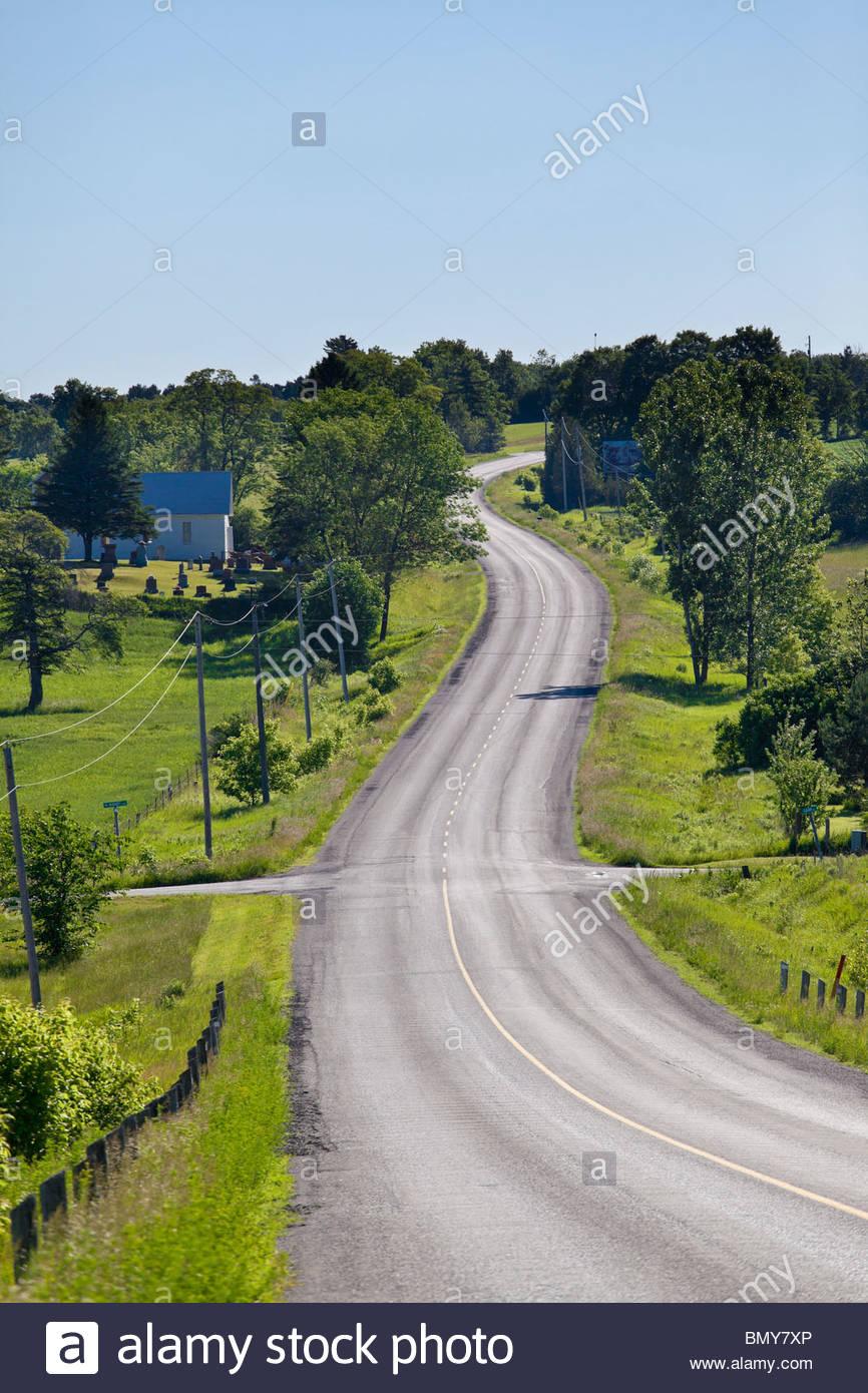 Country road near hamlet of Morganston in the rolling farmland near Colborne Ontario Canada - Stock Image