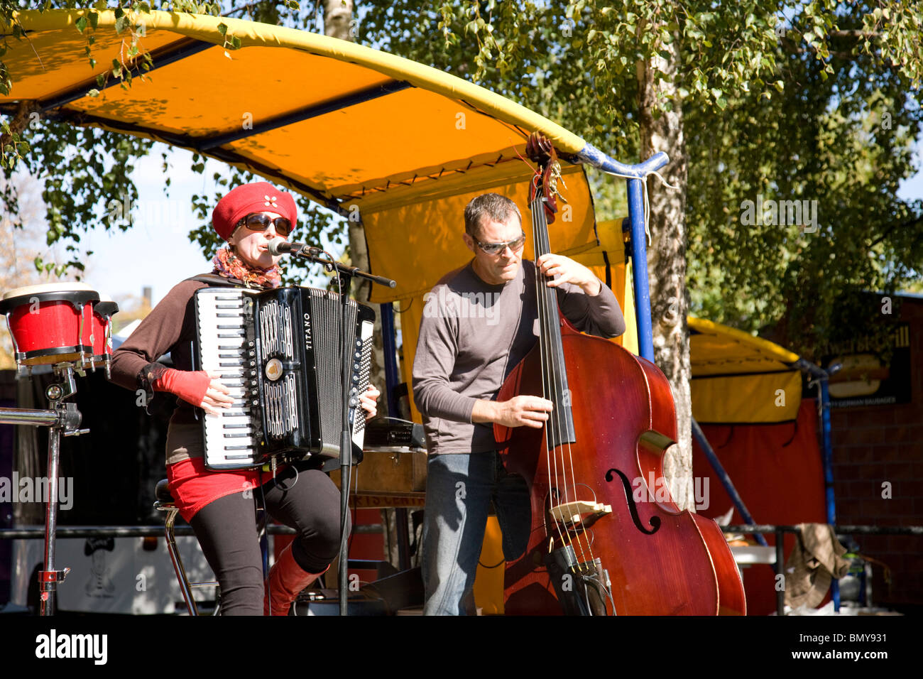 duet playing music to the crowd in christchurch,new zealand - Stock Image