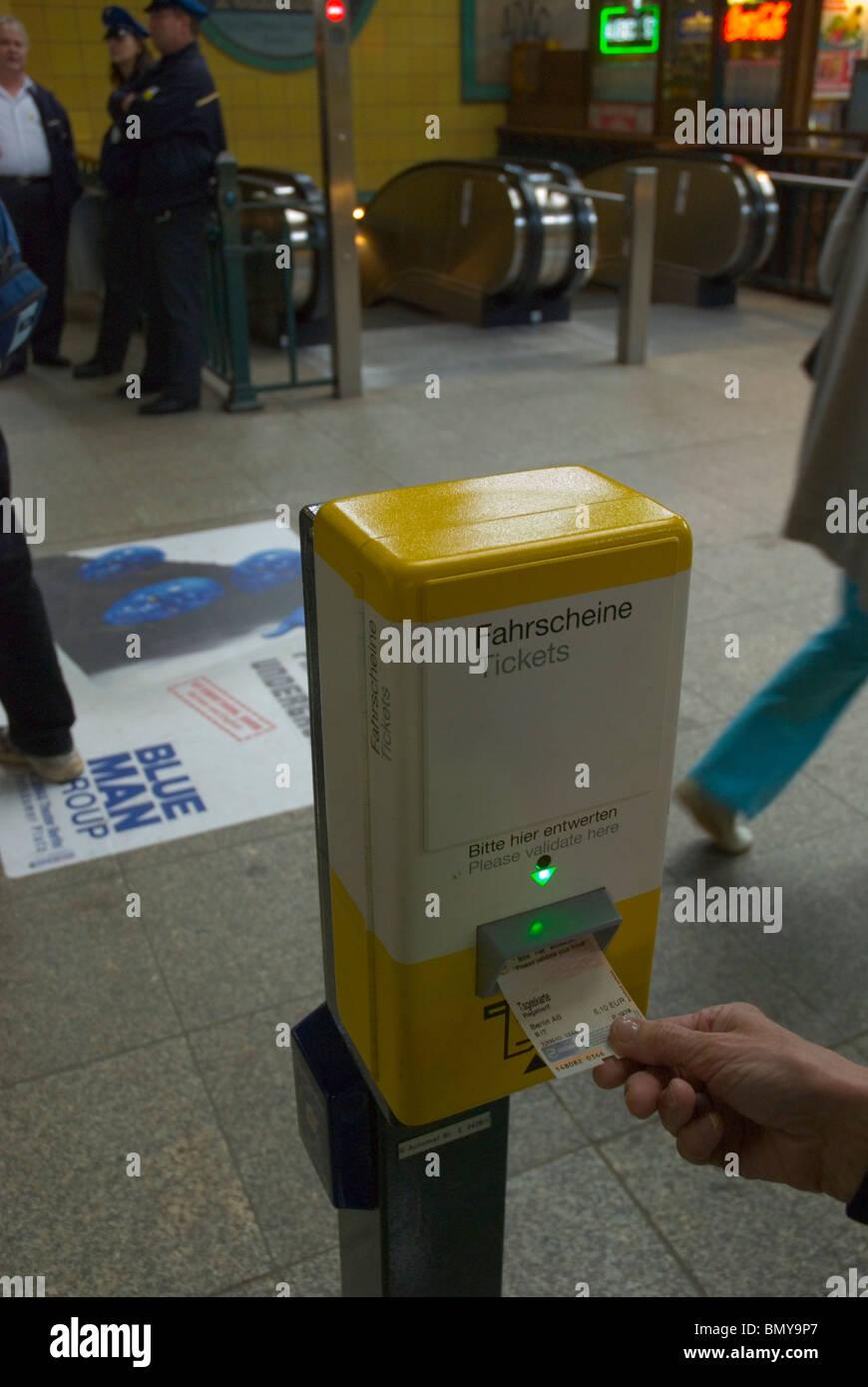 Person validating her ticket at Winterbergplatz metro station west Berlin Germany Europe - Stock Image