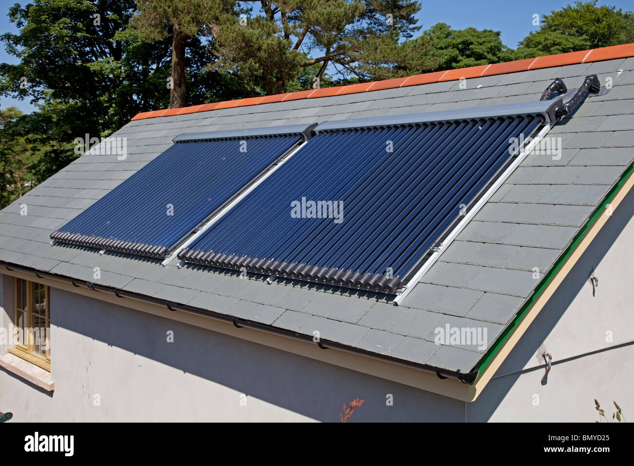 Solar thermal panels on roof of Woody Bay Station Parracombe North Devon UK - Stock Image