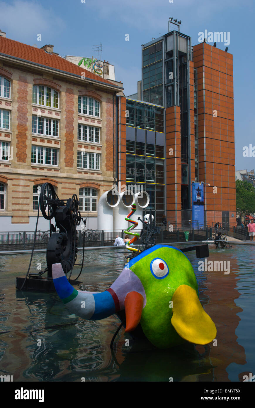 Artwork in the fountain in front of extension building of Centre Pompidou Le Marais central Paris France Europe - Stock Image