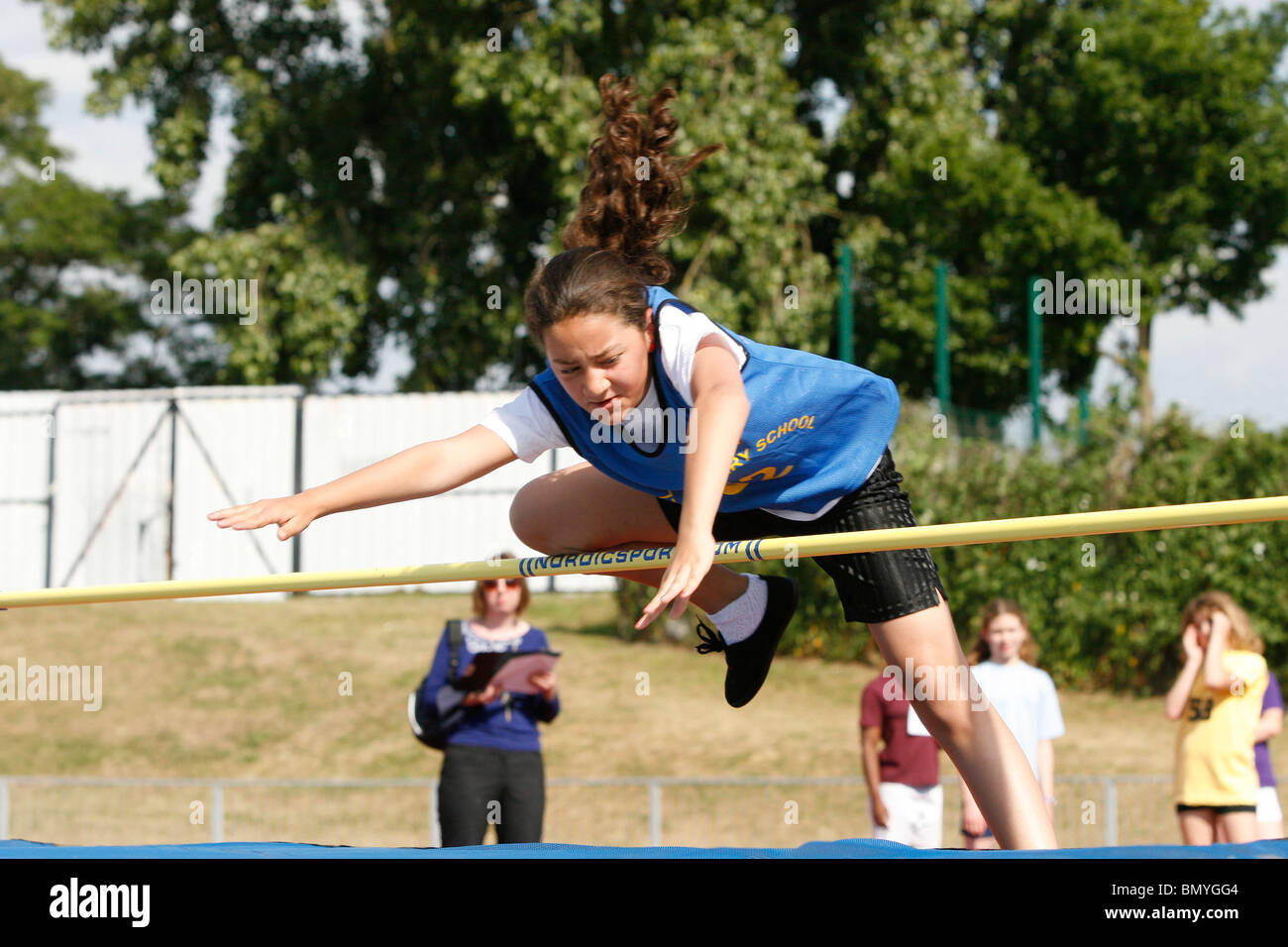 11-12 year olds compete in the Croydon primary schools' athletics championships at Croydon Arena - Stock Image