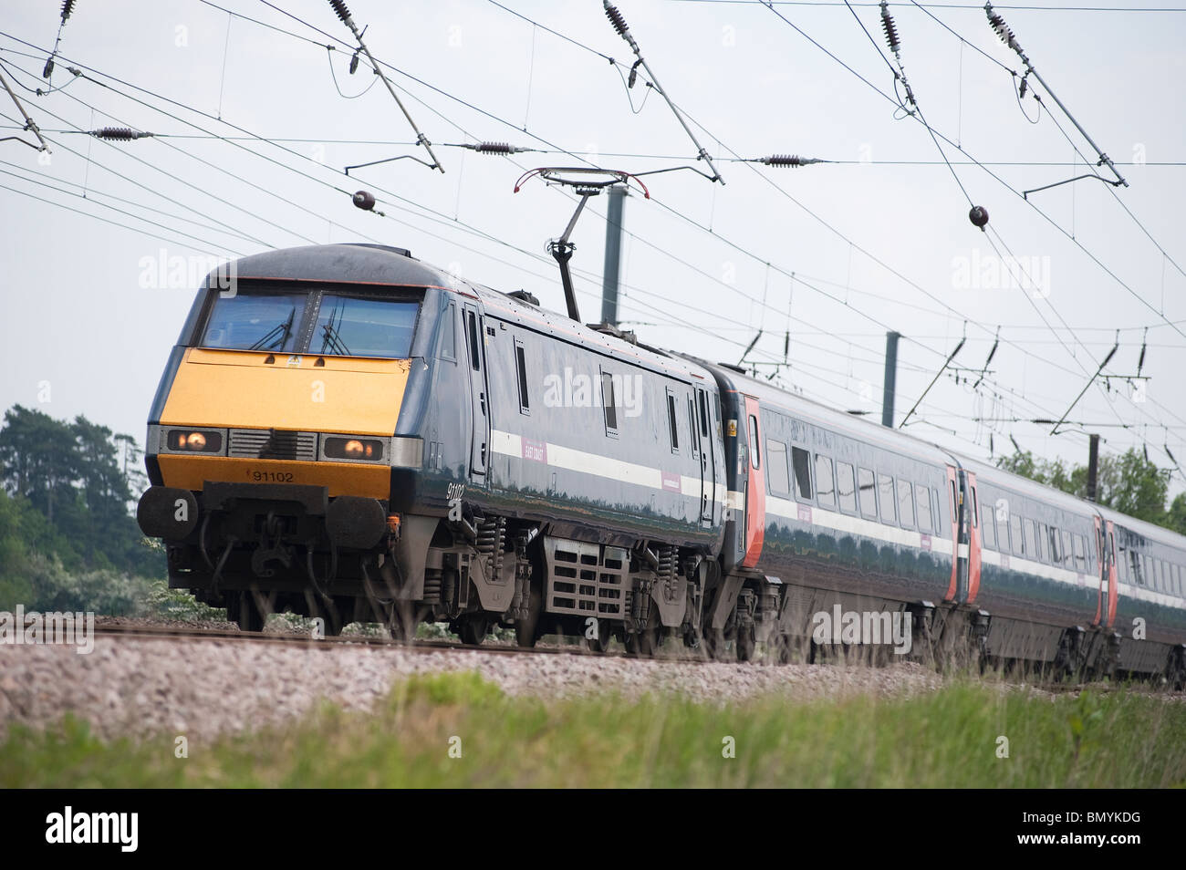 East Coast high speed passenger train travelling at speed along the east coast main line in England. - Stock Image
