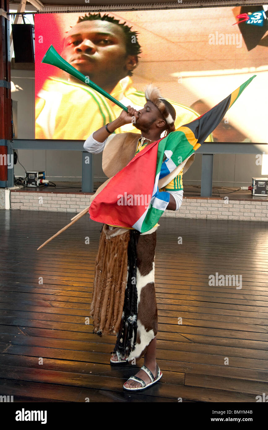Supporter dressed as worrior at public viewing FIFA World Cup 2010 in Cape Town South Africa - Stock Image