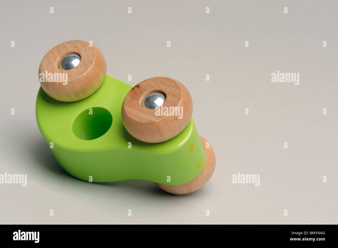 Toy wooden car upside down - Stock Image