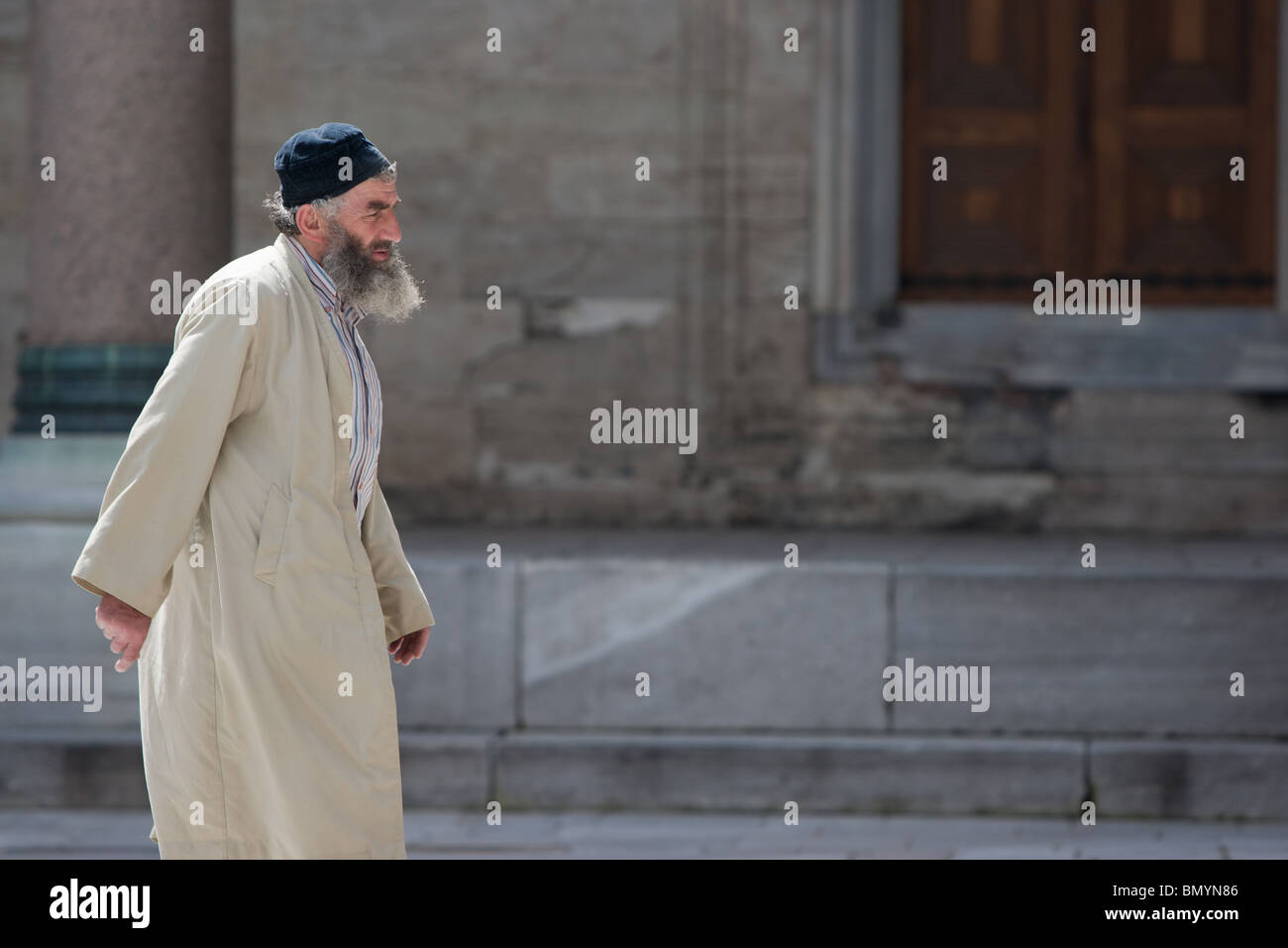 Old Muslim man with beard in mosque, Istanbul, Turkey - Stock Image
