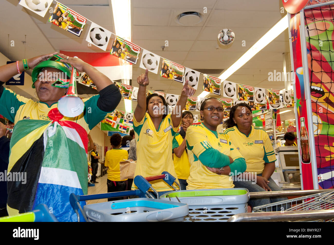 Employees of a supermarket watching a match of the FIFA World Cup 2010 in Cape Town South Africa Stock Photo