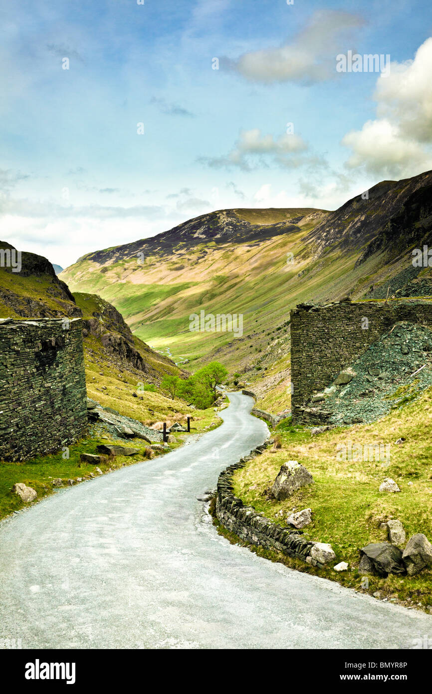 Winding road at the summit of Honister Pass, the Lake District, Cumbria, England, UK - looking towards Buttermere - Stock Image